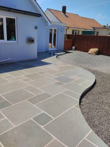 Stonemasonry bespoke stone paving that is cut in a curve shape.