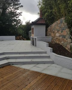 landscaping company in Guernsey. Wooden decking and white patio area ready for outdoor seating.