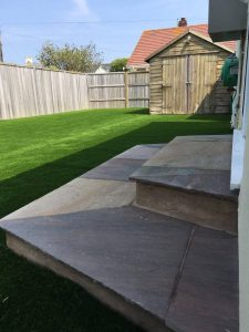 artificial grass customer design, view of realistic artificial grass bespoke design for a back garden.