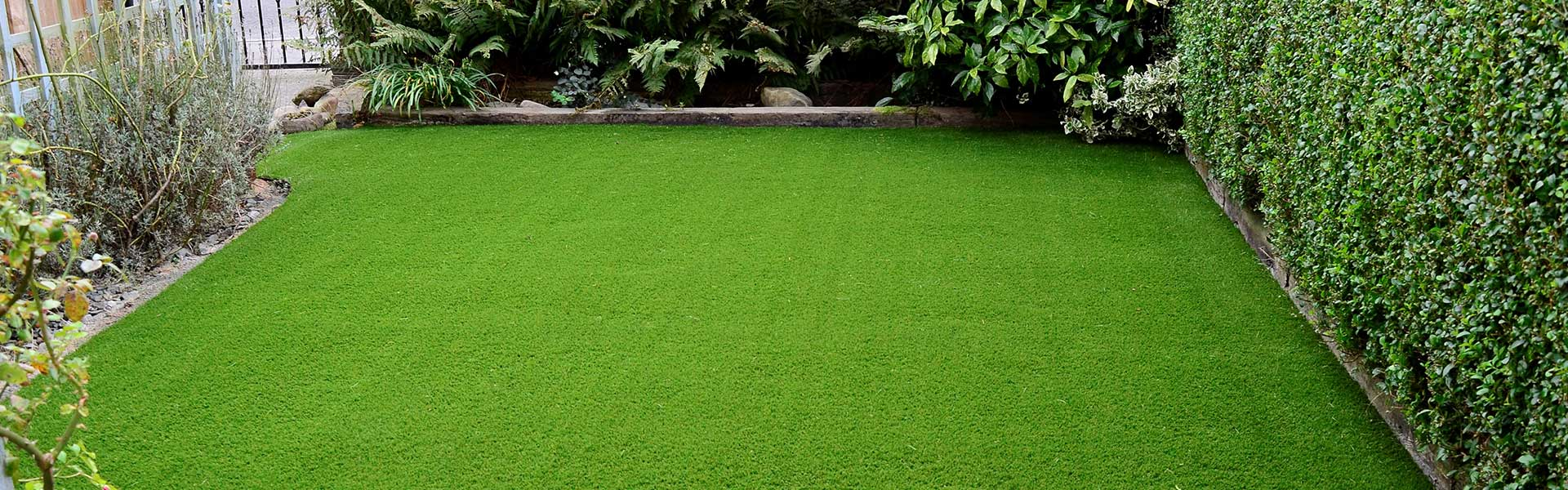 Freshly laid artificial grass in Guernsey for a small garden.