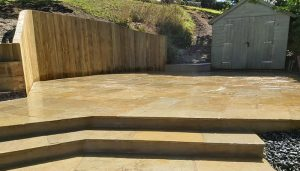 Here we have completely transformed a garden in Guernsey by adding steps and a patio area on a hill.