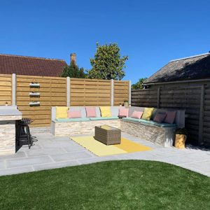 Garden landscaping team in Guernsey, recent landscaping project included patio and custom outdoor seating.