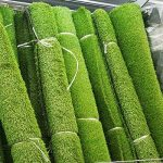 A line of rolled up artificial grass we supply.