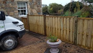 Small fence we erected at the bottom of a driveway. This is a wooden fence using solid wooden posts.