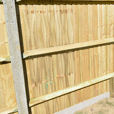 Should you use concrete or wood fence posts?
