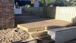 garden patio contractors, small wooden steps that lead up from the side garden to back garden with old wooden decking.