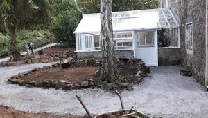 Finished greenhouse restoration and repair project in Guernsey. Installed a new pathway.