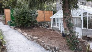 Repaired greenhouse in Guernsey with new walk way installed.