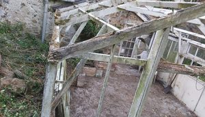 Close up of rotten wood framework that needs replacing.